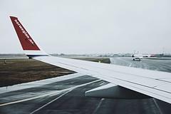 (jean_pichot1) Tags: tarmac winter wet rain shapes angular horizon sky blue dawn red airline norwegian runway flight window airplane wing