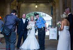 Groom Insists on Photo with Officer (ViewFromTheStreet) Tags: allrightsreserved architecture artgallery blick blickcalle blickcallevfts bride calle candid cityhall copyright2016 groom pennsylvania philadelphia phillysfinest photography stphotographia streetphotography viewfromthestreet weddingparty amazing arch beauty bouquet classic cop couple female flowers gun love male man marriage officer police policeofficer pretty smile smiling street tux tuxedo vftsviewfromthestreet wedding weddingdress woman blickcallevfts copyright2016blickcalle