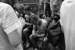 An obsessed Pokmon fanboy (jenny_guo) Tags: xpro2 carlzeiss touit1832 x street people blackandwhite crowd germany dusseldorf