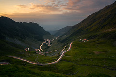 Tangled (CreArtPhoto.ro) Tags: lights longexposure curves romania road sunset balealac cloudy apus mountains trails balea dangerousroad tangled valley transfagarasan