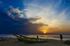 sunrise-a photographers delight (athul vinod) Tags: chennai marina beach india sunrise morning boat people sky clouds