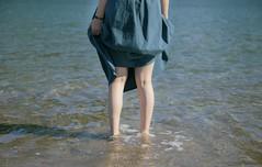 (hirotaka hoshi) Tags:       female leg seashore sandy beach ocean