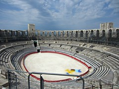 Arles Amphitheatre (AmyEAnderson) Tags: outdoor sporting sport coliseum amphitheatre stadium oval seats towers arches archways bleachers sky clouds contrasts ring geometric horizon historic arles france bouchesdurhone provence red architecture skyline unesco