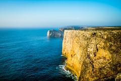 Rock All the Way (D.ROS) Tags: 2016 beach blue cape cliff landscape light magenta nature orange plants portugal rocks sagres sand seayellow sun sunrise sunset water white supershot