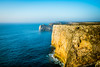 Rock All the Way (D.ROS) Tags: 2016 beach blue cape cliff landscape light magenta nature orange plants portugal rocks sagres sand seayellow sun sunrise sunset water white supershot