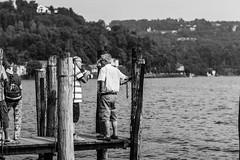 Chiacchiere sul molo (MaxDeVa) Tags: 50mm leica ggrfilter lago summiluxm blackandwhite torino bw ortasangiulio f14 monochrom