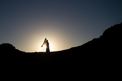 The Greatest Dancer (Universal Stopping Point) Tags: mountain silhouette scarf evening rocks dress desert dancing backlit saudiarabia medinaprovince
