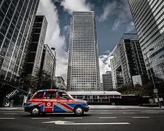 London Calling (Baggers~) Tags: uk blue red white london skyscrapers britain financialdistrict shops british canarywharf unionjack londoncalling blackcab finance tallbuilding tallestbuilding onecanadasquare flickrchallengegroup flickrchallengewinner whatsmorebritishthanablackcab