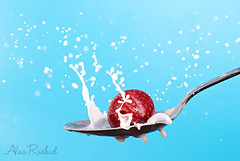 strawberry splash 50/9 (Alaa rashid | ) Tags: blue sky milk strawberry spoon splash