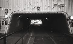 (SamBHart) Tags: bw black white nikon fm2 film 35mm nikkor 24mm lens isla vista bridge underpass tunnel handrail lighting dark light posters run down rundown goleta nikonfm2 35mmfilm 400iso kodak ultramax 400