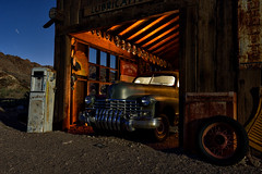 cadillac. eldorado canyon, nv. 2016. (eyetwist) Tags: eyetwistkevinballuff eyetwist night 1946 cadillac sedan chrome grille techatticupmine eldoradocanyon nelson nevada abandoned ruins dark longexposure long exposure fullmoon desert nikon d7000 nikkor capturenx2 1024mmf3545g npy nocturne highdesert americana americantypology american typology dead empty desolate lonely derelict decay nv wideangle 1024mm shadow mojavedesert ruin lightpainting old vintage rust rusty southwest startrails star trails techatticup mine typography ghosttown touristtrap coloradoriver hood ornament windshield patina headlights carmageddon wheel hubcaps garage gas gasoline pump signs royalcrowncola quakerstate barn