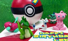Lena - Pokemon Birthday Cake (PerfectionistConfectionist) Tags: pokemonbirthdaycakepokeballcake cakedublin pikachu mew porygon dratini vaporeon tyranitarcaketoppers