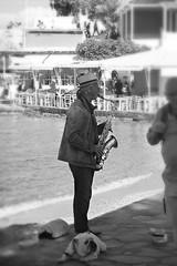 Mykonos (n.cordery) Tags: harbourside busking dog sax greece streetphotography