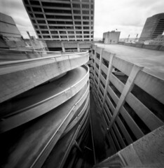 Diverging convergence (Zeb Andrews) Tags: realitysosubtle6x6 pinhole film mediumformat portland lensless 6x6 blackwhite lines kodaktmax100 parkinggarage urban cityscape oregon pacificnorthwest