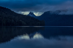 Mt Ida (robertdownie) Tags: sky sunrise lake mountains water reflection clouds rock rocks snow dawn peak australia ominous rainforest wilderness tasmania crag high country national park highlands range travellers mt ida cradle mountainlake st clair
