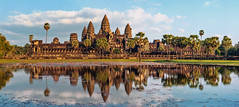 Ancient Khmer architecture. Panorama view of Angkor Wat temple at sunset. Siem Reap, Cambodia (vietnamtourpedia) Tags: angkor cambodia thom ancient antique archeology architecture asia asian buddhism building civilization culture destination east exterior famous heritage hindu hinduism historic khmer lake landmark lotus monument old reap reflection religion ruins siem site sky southeast spirituality stone sunset temple tourism tower traditional travel unesco wall wat wisdom wonder world worship cambodiatourpackages cambodiaholiday traveltocambodia