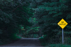No Outlet Sign on a Michigan Forest Road (Lee Rentz) Tags: america caution centralmichigan country danger dangerous dark darkness deadend eerie forest icon mecostacounty michigan nooutlet northamerica omen pines road rural scary sign stanwood strange twilight twilightzone usa woods