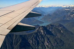Time Flies (Peggy Collins) Tags: canada mountains plane river rockies britishcolumbia jet aerial rockymountains mountainrange planewing canadianrockies snowcappedmountains jetwing aeriallandscape onwing peggycollins
