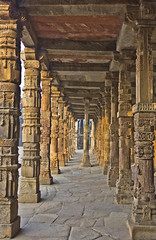 Pillars (AnkurDauneria) Tags: world travel india art heritage tourism monument architecture century canon temple eos site war worship asia muslim mosque unesco mausoleum monarch 1855mm pillars hindu 12th efs emperor newdelhi qutubminar watchtower quran asi towerofvictory subcontinent redstone mughal rajput redsandstone archaeologicalsurveyofindia ghori iltutmish incredibleindia victorytower indraprastha apsc qutubuddinaibak 27hindutemples
