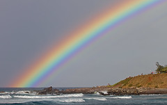 rainbow over surf (bluewavechris) Tags: ocean sea sky color beach water weather clouds island hawaii rainbow surf action wave maui hookipa
