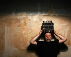 Portrait of a Man preparing to Balance a 100 Year Old Accordian on his Head (Studio d'Xavier) Tags: 365 accordian antebellum gonewiththewind 365days strobist werehere stuffonmyhead theoldsouth 321366 november162012