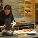 Chef Conant preparing the shorts ribs with garlic chips and horseradish