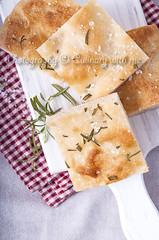 Rosemary Focaccia (vanilllaph) Tags: food vertical closeup bread recipe table baking italian warm cut eating dough salt towel gourmet delicious eat homemade rosemary piece focaccia bake herb culinary baked tasy