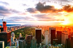 Sunrise in New York City on June 20, 2012 (mudpig) Tags: nyc newyorkcity light cloud newyork reflection skyline sunrise geotagged cityscape centralpark 5thavenue flare upperwestside hudsonriver gothamist goodmorning hdr topoftherock observationdeck bloombergbuilding essexhotel fourseasonshotel solowbuilding mudpig stevekelley avonbuilding stevenkelley