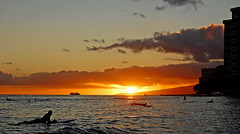 Sunset Cruising (jcc55883) Tags: ocean sunset sky clouds hawaii nikon waikiki oahu horizon pacificocean surfers waikikibeach d40 kuhiobeachpark nikond40 waikikibeachcenter yabbdabbadoo