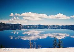 Crater Lake Reflections (Shutterbug Fotos) Tags: blue mountain lake snow reflection beauty clouds wonder mirror nationalpark cyan clear craterlake awe cian cloudscapes mountmazama top20blue ricohrw1