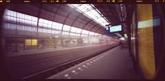 Departure Thalys Amsterdam (optamatic) Tags: paris 120 amsterdam holga superia pinhole epson 100 asa centraalstation 18 anti glas seconds newton fujicolor thalys wpc amsterdamcs v500 rolfilm 6x12cm holgawpc holgawpc120