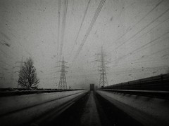 North-West (Yves Roy) Tags: street city shadow urban blackandwhite bw black contrast dark austria blackwhite raw moody darkness noiretblanc 28mm snap fav20 freeway gloom blizzard fav30 yr enigmatic fav10 fav40 ricohgrd blackwhitephotos grdiii bureboke yvesroy yrphotography
