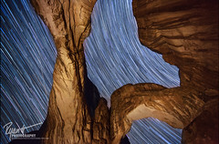 Double Arch Stars (Ryan C Wright) Tags: red night utah sandstone december arch astrophotography moab stacking navajo archesnationalpark startrails doublearch turretarch thewindows coldnightinthepark