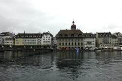 Buildings and river Reuss in Lucerne (Ashish A) Tags: city bridge cloud water caf clouds river switzerland swan waves swiss flag luzern tourist flags tourists swans lucerne touristattraction cloudysky pedestrianbridge riverreuss cloudsinsky swaninriver