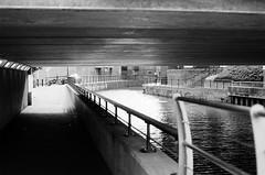 Under the Bridge (Jeanine Marteau Photography) Tags: 35mmfilm filmphotography blackandwhite ilford chinon canal bridge
