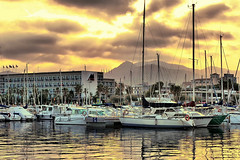Glistening sunset (Fnikos) Tags: port light cloud golden gold sea water waterfront boat sky skyline serene vehicle city outdoor