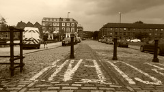Hull - former Princes Dock railway - old track in road, Wellington St  East (dave_attrill) Tags: hull princes quay docks waterfront railway shipping tracks cobbles and barnsley line hb wellington street swing bridge bollards st