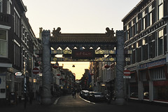 Chinatown The Hague (Ron van Zeeland) Tags: chinatownchina denhaag holland thenetherlands asians neighborhoods street outdoor construction chinese thehague nederland road building architecture city lahaye buildingcomplex buildingstructure infrastructure sunset