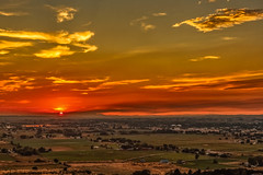 Last Of The Sun (http://fineartamerica.com/profiles/robert-bales.ht) Tags: forupload projects gemcounty idaho sunset sunrise yellow landscsape mountain morning twlight panoramic emmett sweet squawbutte farm landscape rollinghills scenic idahophotography treasurevalley clouds organe emmettvalley emmettphotography trees sceniclandscapephotography thebutte haybales canonshooter beautiful sensational awesome magnificent peaceful surreal spiritual inspiring inspirational wow stupendous superb tranquil town butte robertbales iphone