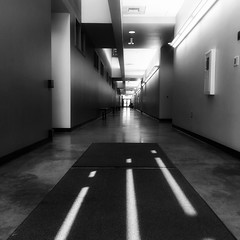Glowing hall (davidleearch) Tags: hall black white photography interior architecture college california sacramento cosumnes light lighting