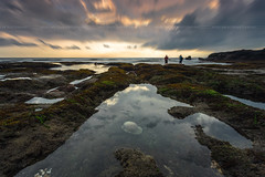 Two Photographers were capturing the moment at Melasti Beach, Bali Indonesia (HakiimMislam) Tags: melasti beach landscape seascape sunset sun setting sky cloud indonesia bali sony raymaster filter longexposure