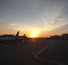 Sunset in Miami (Rob Hall -) Tags: miami sun light sunlight sunshine airport planes aircraft jets runway terminal usa nexus6 evening dusk twilight shining glare warm warmth shadow colors color colours colour beauty beautiful travel vacation holiday airlines parked waiting