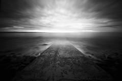 Immersioni (bebo82) Tags: longexposure sea blackandwhite bw dock nuvole mare pentax molo biancoenero trieste lungaesposizione pentaxk20d pentaxk20 clouds