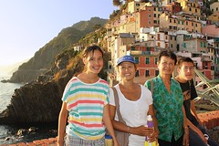Samantha, Kanitha, Bunrod and BieJee in Riomaggiore (B℮n) Tags: world ocean park family flowers blue houses sunset sea summer vacation portrait sky orange sun sunlight moon holiday flower tower heritage classic water colors beautiful weather night buildings walking boats coast boat high fishing warm mediterranean italia sailing ship torre gulf view hiking path five liguria shoreline hike case cliffs lovers quay historic unesco via anchovies national wharf terre sail botanic mountainside quaint viewpoint picturesque coloured cinque adriatic riomaggiore italianriviera torri dellamore guardiolas