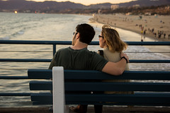 Looking at the sunset (raymondwy) Tags: california sunset hugging couple santamonica lovers