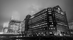Shadows And Fog (Sean Batten) Tags: city uk bridge england urban blackandwhite bw london fog nikon cityscape shadows docklands canarywharf hsbc onecanadasquare d90 barclayscapital