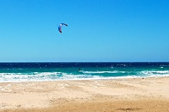 riding waves. (krnjn) Tags: ocean sea kite beach spain mediterranean wind windy surfing kitesurfing atlantic tip windsurfing andalusia tarifa beachside southernmost southernmostpointofeurope