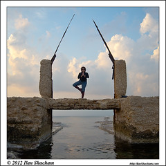 Yoga in the ruins on the sea (Ilan Shacham) Tags: ocean bridge sea woman seascape man tree beach water beauty yoga clouds square landscape israel ruins view scenic meditation moat neveyam treepose atlit serenitytranquility