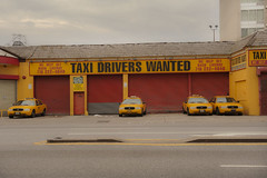 Taxi depot on Fourth Avenue in Gowanus, Brooklyn, New York, USA, (jackie weisberg) Tags: city nyc newyorkcity red urban usa signs ny newyork water sign yellow architecture brooklyn port canal industrial mercury cab taxi cities yellowcab environmental cleanup dump taxis canals neighborhood photograph american sewage pollution gowanuscanal waters daytime newyorkstate impressio