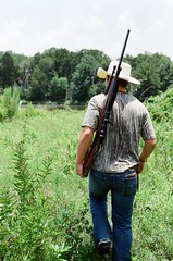 (katmparker) Tags: ranch trees boy people plants man guy nature grass hat person cowboy gun texas farm rifle hunting jeans land cammo cowboyhate